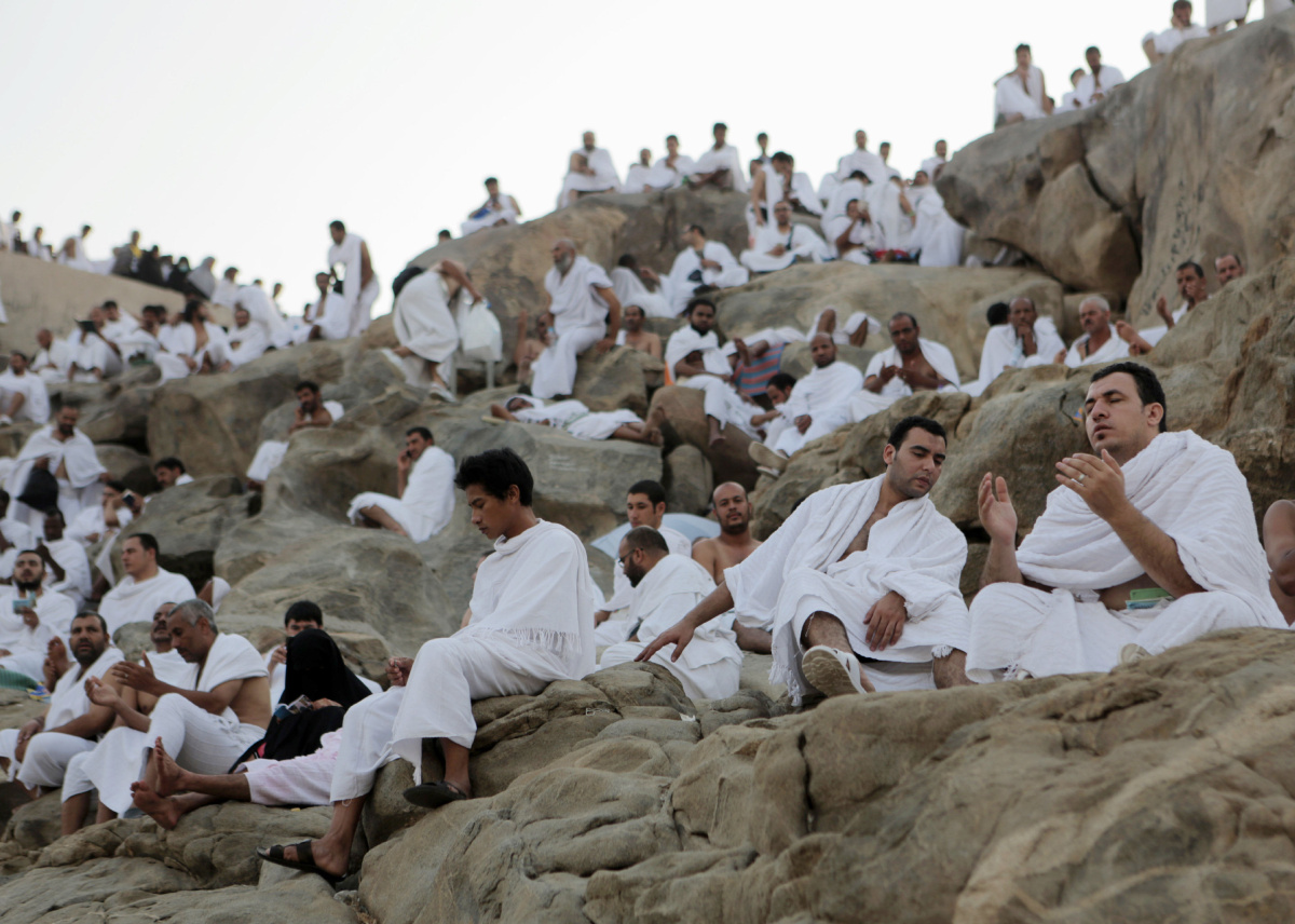 Muslim pilgrims gather to pray at Jabal Al Rahma holy mountain, or the mountain of forgiveness, during the annual pilgrimage, known as the hajj, near Mecca, Saudi Arabia, Friday, Oct. 3, 2014. An estimated 2 million Muslims are streaming into a sprawling tent city near Mecca for the annual hajj pilgrimage. Saudi Arabia banned hajj and work visas this year for people from Sierra Leone, Liberia and Guinea as a precaution to avoid the spread of Ebola during hajj, which sees massive crowds of people from around the world gather in Mecca. (AP Photo/Khalid Mohammed)